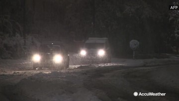 Heavy snowfall leaves one dead and hundreds of thousands without power