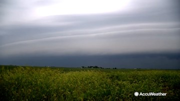 Dramatic shelf cloud completely covers the sky ahead of thunderstorm