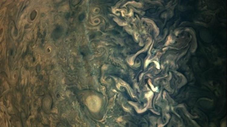 Check Out This Strange Haze Streak Floating Above Jupiter's Cloud Tops