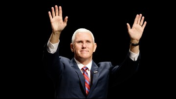 Dozens protest Mike Pence at Taylor University commencement
