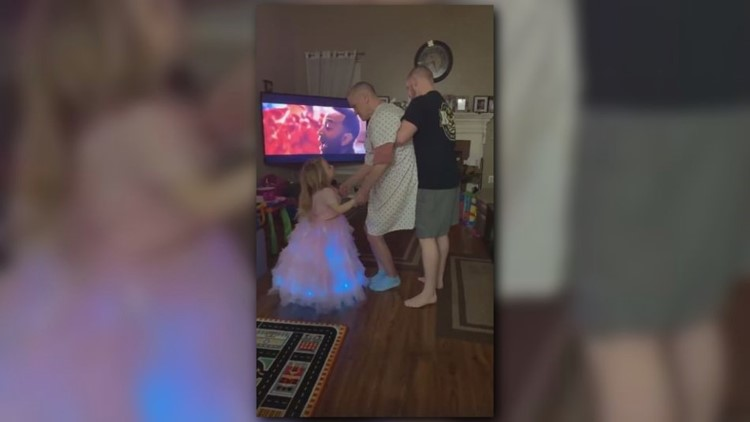 Marine vet helps dad with Alzheimer's dance with granddaughter