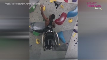 Man in wheelchair rock climbs