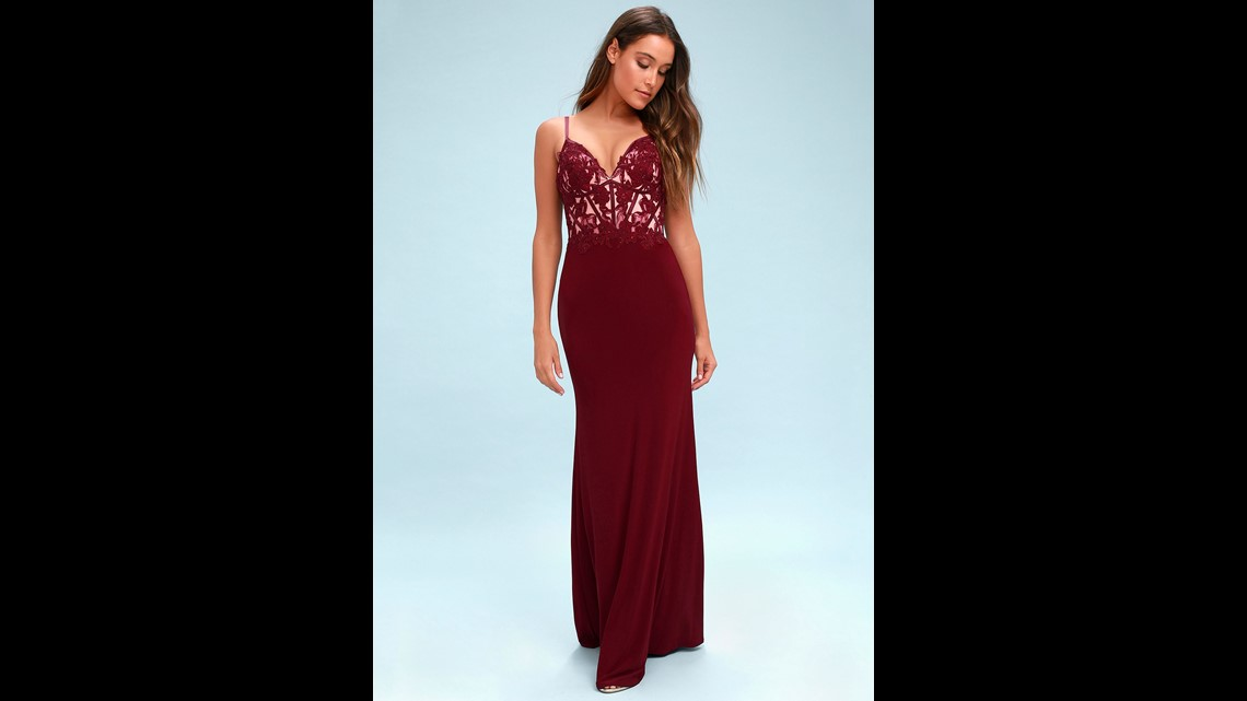 2a71754238 This burgundy embroidered gown also features lace and rhinestones on its  bodice