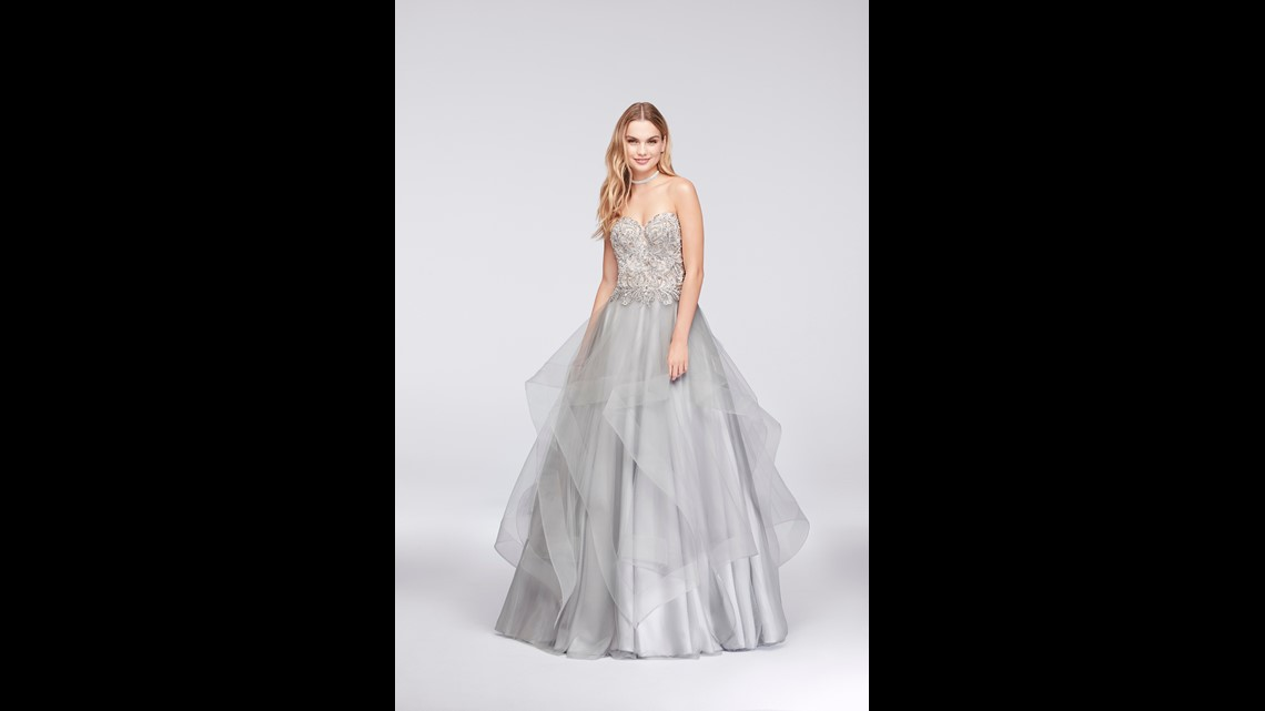 a84efaad05c Try this ruffle-skirted ball gown from David s Bridal   329.95 on sale for   164.98.