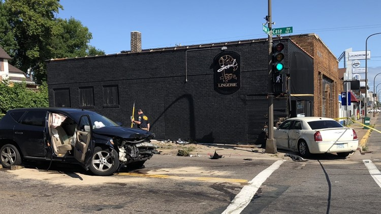 Pedestrian hit after cars collide, crash into building in St. Paul