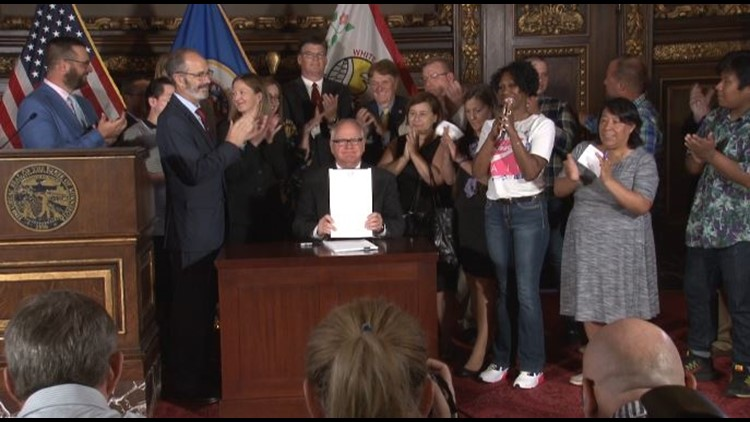 Gov. Tim Walz signs tough new wage theft law.