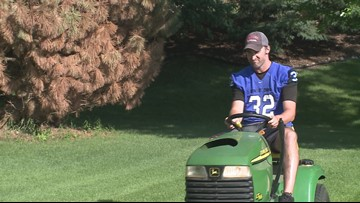 Football coach mows rival's lawn after losing bet