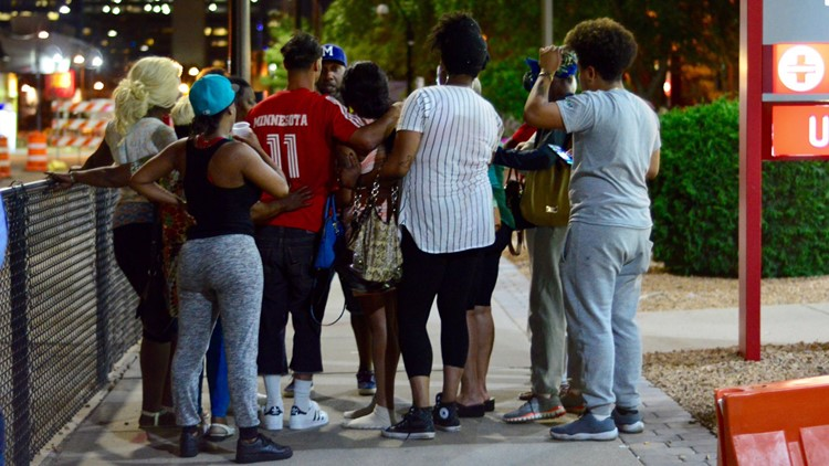 Family and friends gather outside Hennepin County Medical Center, where Philando Castile was taken after being shot by a St. Anthony police officer.