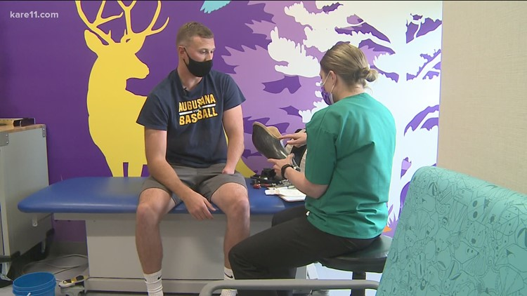 College pitcher gets fitted for new prosthetic arm after having his stolen