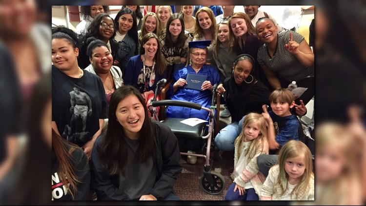 88-year-old Esther Begam is surrounded by Wayzata High School students following her commencement