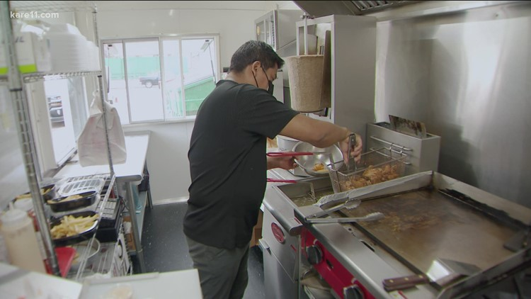 Eleven months after his restaurant burned during rioting, a determined owner cooks in a trailer in an alley