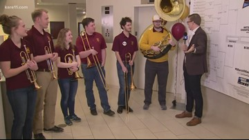 Kent Erdahl checks in with Gopher pep band in Des Moines