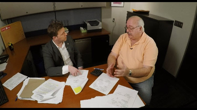 Whistleblower Steve Kleiber reviews police car invoices with KARE 11's A.J. Lagoe. (Photo: KARE 11)