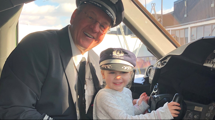 Brian Lenzen and his granddaughter in the 787 cockpit on a flight to Dallas - their last together before his retirement.