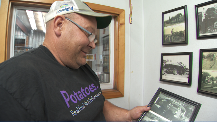 Jeff Edling holds an old picture of his father.