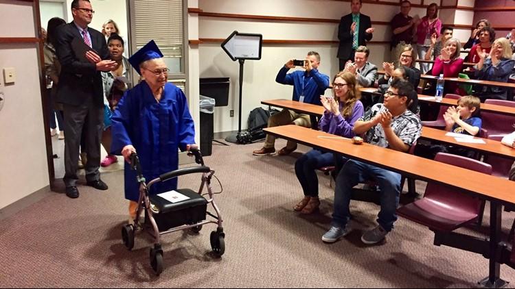 88-year-old Ester Begam enters an auditorium at Wayzata High School for her graduation