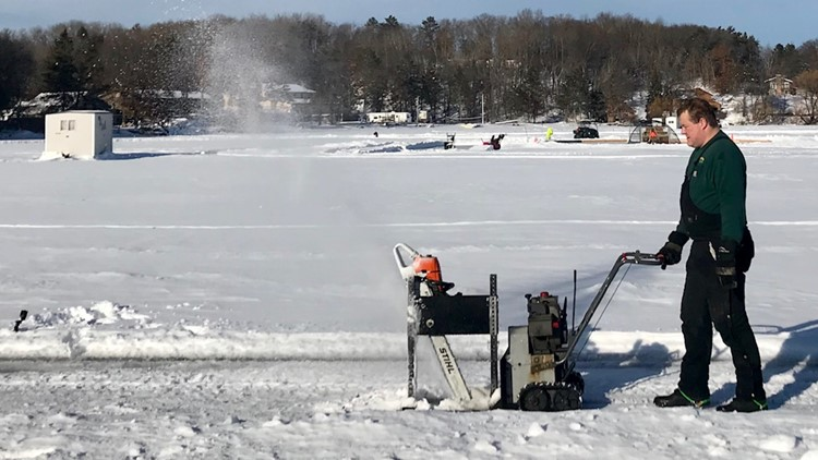 Bo Meyer helps cut the ice for the world-record-setting ice carousel
