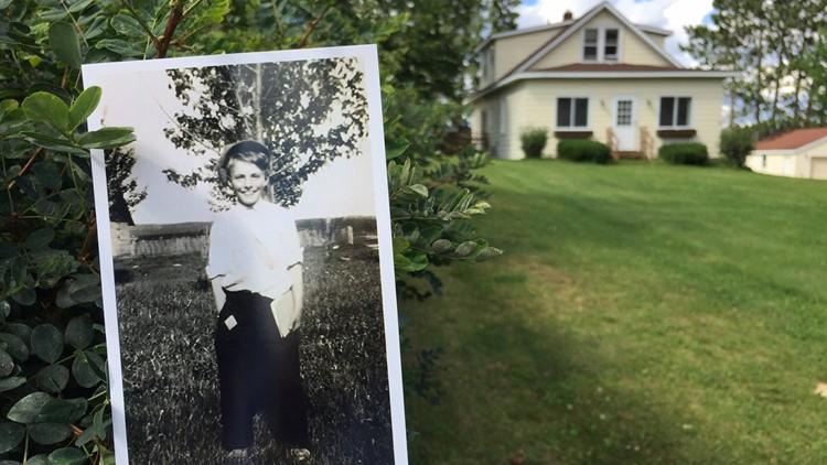 Photo of John Ponikvar taken in front of his boyhood home in Chisholm, Minnesota