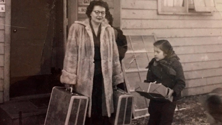 Shirley Ponikvar and her 7-year-old daughter Janie leave Elmendorf Air Force Base in Alaska after the death of Shirley's husband