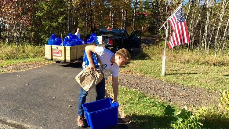16-year-old Noah Brugle makes a pick-up on his curbside recycling route