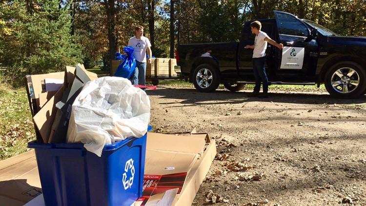 16-year-old Noah Brogle (right) and his father, Jason Brogle, make a recycling pick-up