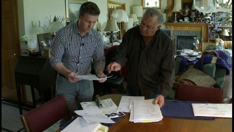 KARE 11 investigative reporter A.J. Lagoe and veteran Roger Roath pour over his loan records