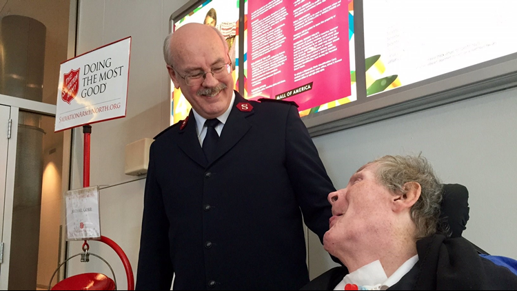 Major Robert Doliber of the Salvation Army visits with Michael Gorr