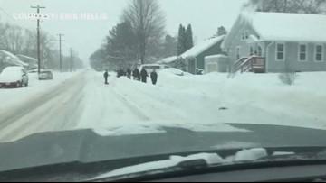 Amery Wisconsin Bantam hockey team spends snow day shoveling