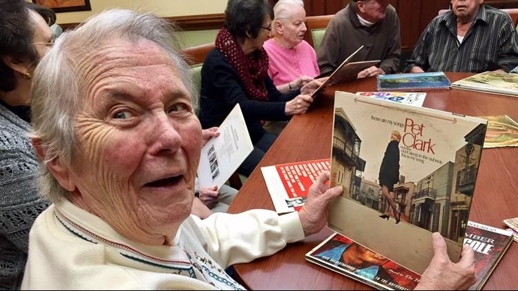 Mary Schramski holds an album at Preferred Senior Living in Ellsworth, Wisconsin