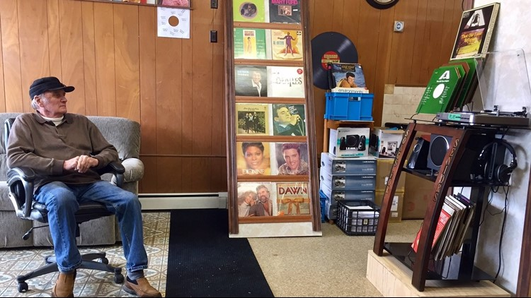Bob Knutson, founder of Songs for Seniors, listens to a record album