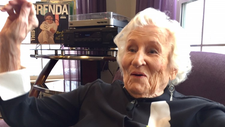 Ninety-eight-year-old Virginia Allen listens to record albums at Potter Ridge Assisted Living Community