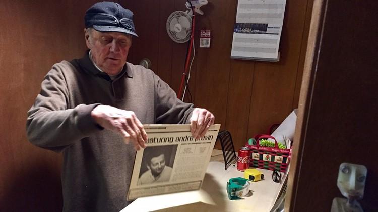 Bob Knutson repairs an album cover.