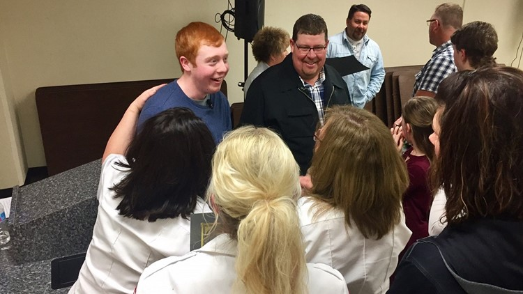 Ryley Pollock receives congratulations from first responders