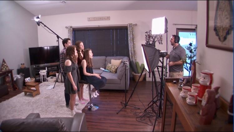 Garrett Lathe (far right) records his children's annual Christmas video.