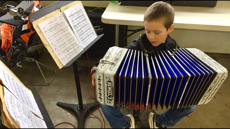 Cameron Mack plays the concertina in his parents' garage