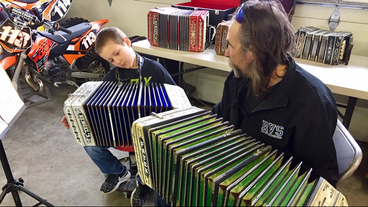 Steve Revitzer gives Cameron Mack a concertina lesson