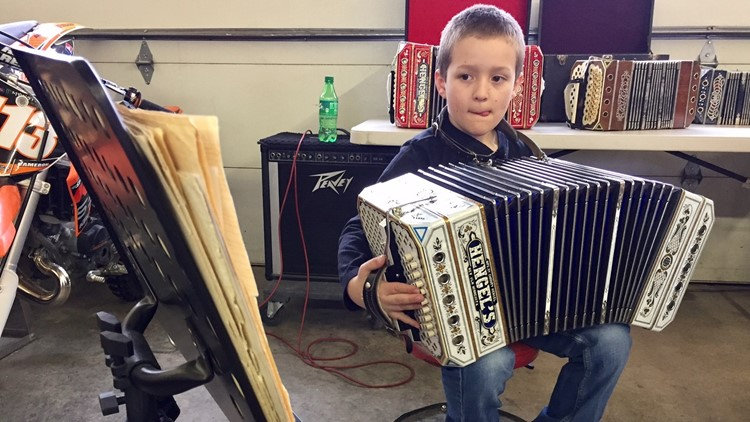 3rd grader Cameron Mack plays his concertina
