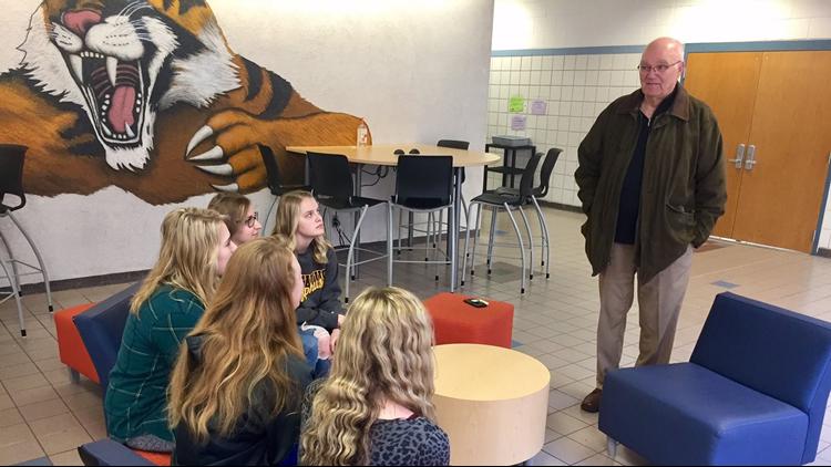 Dennis Frandsen chats with seniors at Rush City High School