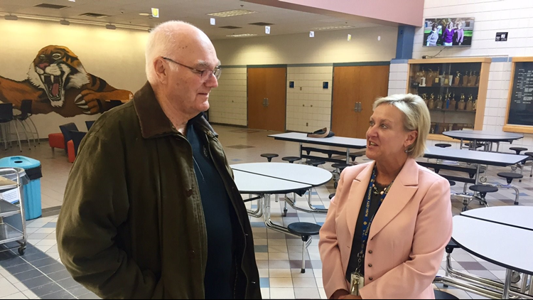 Dennis Frandsen discusses his free tuition offer with Rush City school superintendent Teresa Dupre