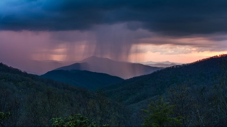 One photographer saw rain move in during a sunset at the mountains and created an awesome display.