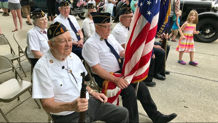 American Legion members sit at attention at the Whalan Stand Still Parade.