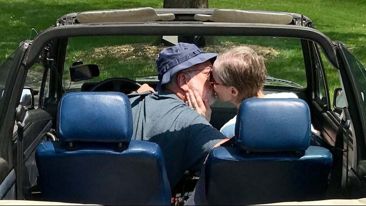 Bob and Kathy Husby share a kiss in their '85 VW Cabriolet