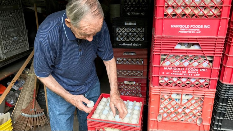 RJ Smith sorts some of his 70,000 golf balls