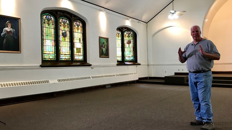 Mark Coen stands in the former Lutheran church he purchased for his casket business