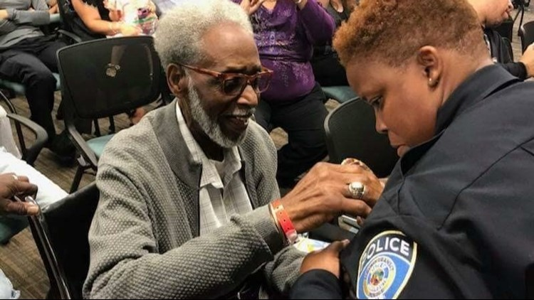 Art Blakey pins a sergeant's badge on his daughter Brooke