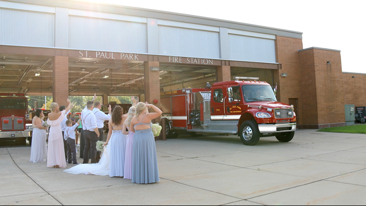 Jeremy Bourasa, inside the fire truck, leaves his wedding
