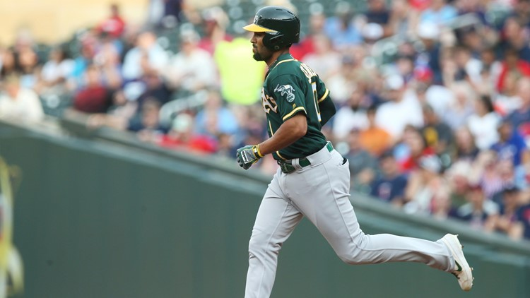 Surging A's beat Twins 5-3