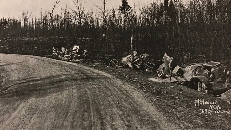 Burned cars along a curve after the 1918 fire
