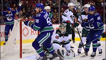 Vancouver dumps red-hot Wild 5-2