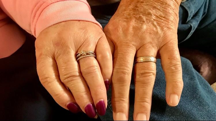 Janet and Gene display their wedding rings